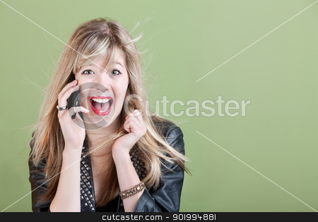 Excited Young Woman on Phone stock photo, Excited retro-styled Caucasian teen on phone over green background by Scott Griessel