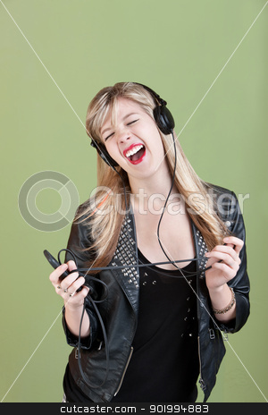 Teen Enjoys Music stock photo, Retro-styled Caucasian teen enjoys music on headphones by Scott Griessel