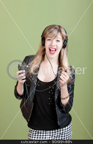 Teen Girl with Headphones stock photo, Happy teenage girl dancing with headphones and mp3 player by Scott Griessel
