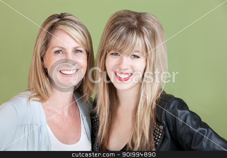 Happy Mom and Daughter stock photo, Happy mom and daughter smile over green background by Scott Griessel