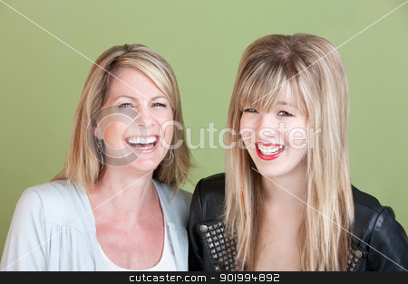 Happy Mom and Daughter stock photo, Laughing Caucasian mom and daughter over green background by Scott Griessel