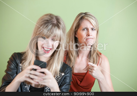 Teen Texting stock photo, Upset woman with laughing teen on cell phone by Scott Griessel