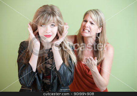 Unhappy Mom stock photo, Unhappy mom yells at daughter over green background by Scott Griessel