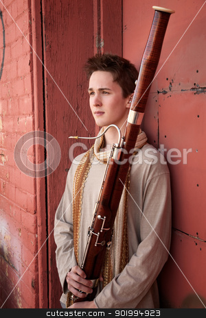 Young Bassoon Musician stock photo, Young Caucasian man outside holds a bassoon  by Scott Griessel
