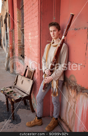 Handsome Bassoon Musician stock photo, Young handsome Caucasian man with Bassoon in his hands by Scott Griessel