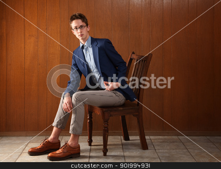 Serious Teen stock photo, Serious Caucasian teen sitting on a wooden chair by Scott Griessel