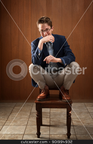 Happy Young Caucasian Man stock photo, Happy young Caucasian man on a chair by Scott Griessel