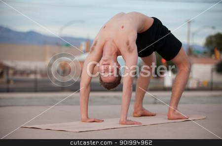 Man in Yoga Position stock photo, Fit young man in Urdhva Dhanurasana yoga posture  by Scott Griessel