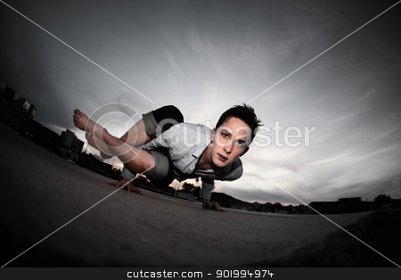 Fit Young Man stock photo, Fit young Caucasian man does yoga posture outside by Scott Griessel