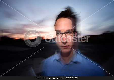 Motion Blur Portrait stock photo, Motion blur portrait of a young Caucasian man outside by Scott Griessel