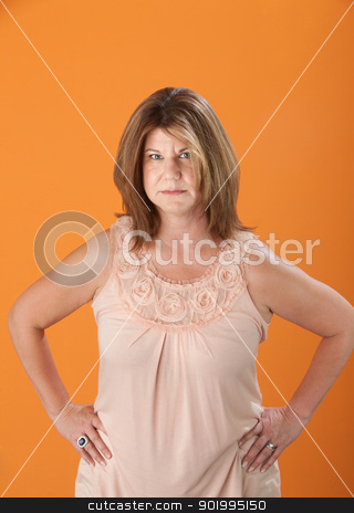 Woman In Suspicion stock photo, Suspicious Caucasian blonde woman on orange background by Scott Griessel