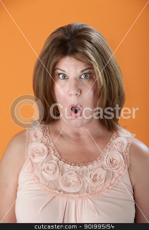 Shocked Woman stock photo, Shocked Caucasian woman on orange background by Scott Griessel