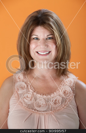 Happy Woman stock photo, Smiling Caucasian woman on orange background by Scott Griessel
