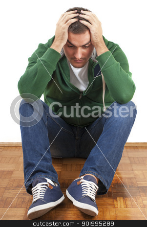 Depressed stock photo, Young depressed male sitting holding his head with both hands by Jenella