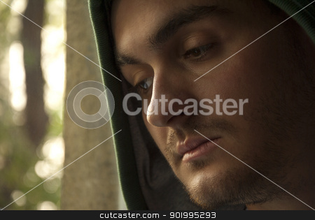 Love trouble stock photo, Portrait of young worried man looking through window by Jenella