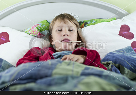 Boy in bed with the flu stock photo, Young caucasian boy in bed with the flu checking if he has any fever by Johan Lenell