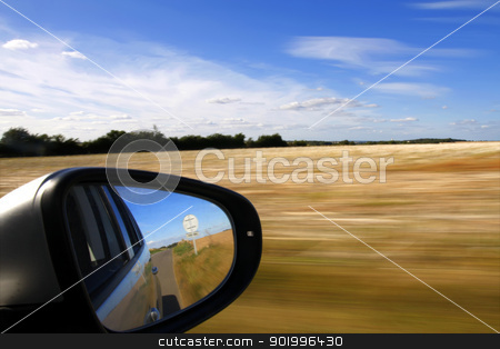 Car mirror with background motion blur stock photo, Car mirror with background speed blur by steve ball