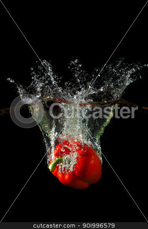 sweet red pepper stock photo, Colored red paprika in water splashes on black background by Sergey Nivens