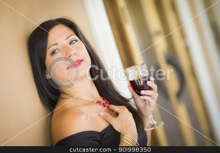 Attractive Hispanic Woman Portrait Outside Enjoying Wine stock photo, Attractive Hispanic Woman Portrait Outside Enjoying a Glass of Wine. by Andy Dean