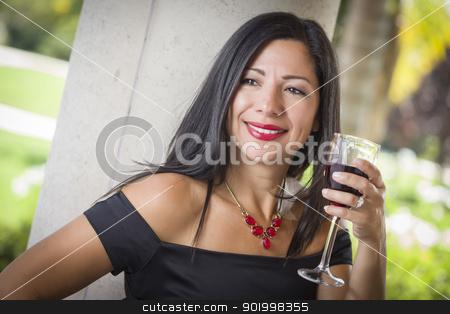 Attractive Hispanic Woman Portrait Outside Enjoying Wine stock photo, Attractive Hispanic Woman Portrait Outside Enjoying a Glass of Wine. by Andy Dean