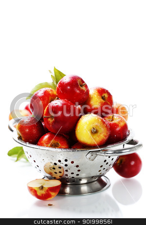 Fresh red apples in metal colander stock photo, Fresh red apples in metal colander over white. With copyspace  by klenova