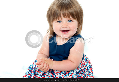 Portrait of an adorable baby girl sitting up stock photo, Portrait of an adorable baby girl sitting up wearing a beautoful blue dress by Ishay Botbol