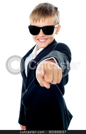 Cheerful young kid pointing towards the camera stock photo, Cheerful young kid pointing towards the camera. Dressed like a businessman by Ishay Botbol