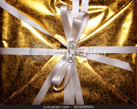 Gift stock photo, Closeup view at the ribbon on the gift box. by Sinisa Botas