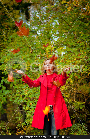 Happy fall woman playing with autumn leaves in forest stock photo, Happy fall woman playing with autumn leaves in forest by Oleg