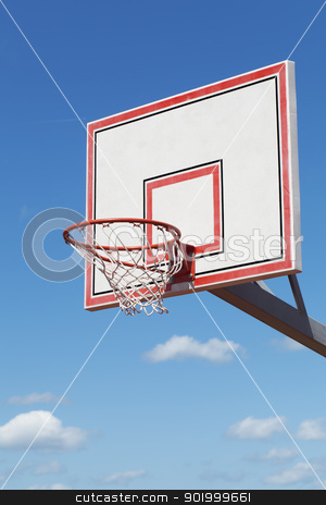 Basketball hoop on blue sky background stock photo, Basketball hoop on blue sky background by ARNIS LAZDINS