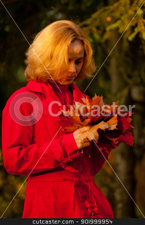 Fall woman stock photo, Fall woman playing with autumn leaves in forest by Oleg