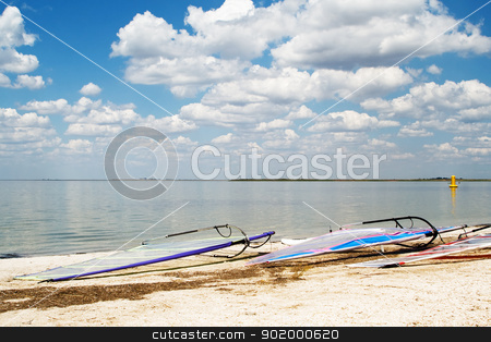 Surfboards on a beach a sea bay on background of the blue sky an stock photo, Surfboards on a beach a sea bay on background of the blue sky and clouds by Sergii Sukhorukov