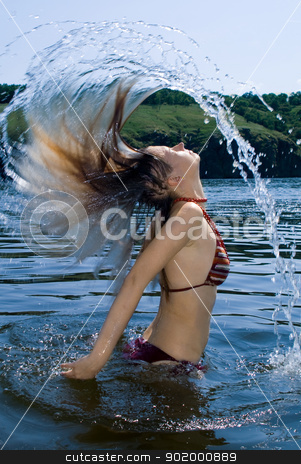 The young woman bathes in the river stock photo, The young woman bathes in the river by Sergii Sukhorukov
