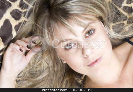 portrait of the young blonde lies on a bed stock photo, portrait of the young blonde lies on a bed by Sergii Sukhorukov