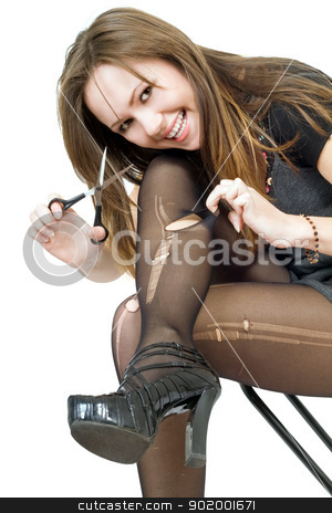 Smiling girl with scissors cuts the stockings. Isolated stock photo, Smiling girl with scissors cuts the stockings. Isolated by Sergii Sukhorukov