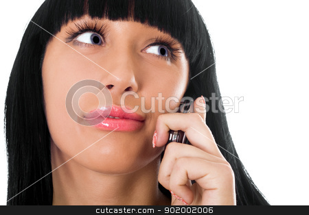 Portrait of the lovely girl speaking on the phone stock photo, Portrait of the lovely girl speaking on the phone by Sergii Sukhorukov