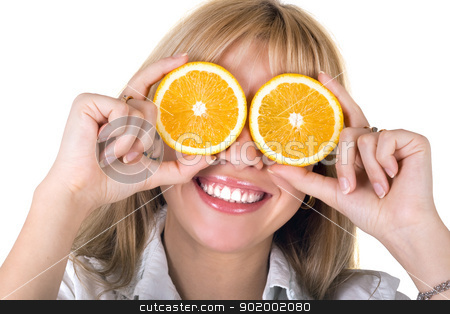 Portrait of the funny smiling girl with oranges. Isolated stock photo, Portrait of the funny smiling girl with oranges. Isolated by Sergii Sukhorukov