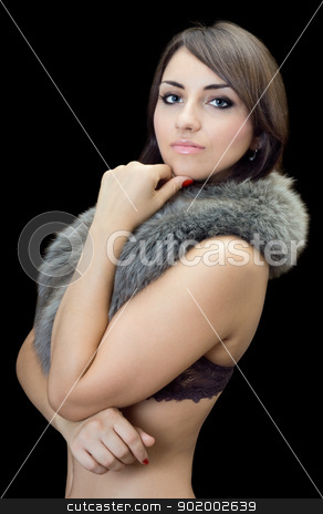 young brunette stock photo, Sexy young brunette posing in fur. Isolated on black by Sergii Sukhorukov