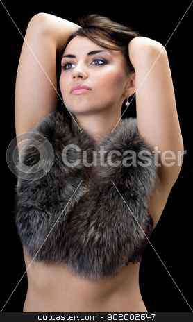 Sexy brunette stock photo, Sexy brunette posing in fur. Isolated on black by Sergii Sukhorukov