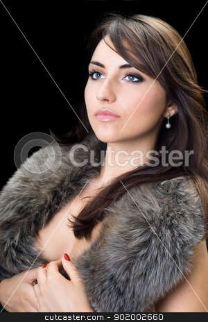 Young sexy woman stock photo, Young sexy woman with thoughtful look posing in fur. Isolated by Sergii Sukhorukov