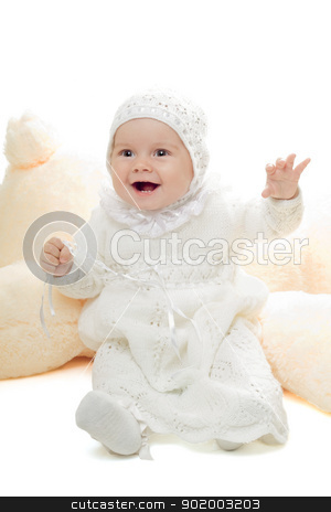 Playful baby girl stock photo, Playful baby girl in bound dress. High key by Sergii Sukhorukov