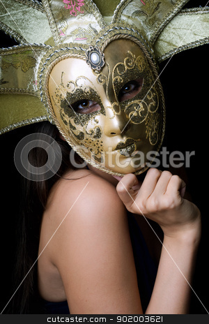 Young woman in a Venetian mask stock photo, Portrait of young woman in a Venetian mask by Sergii Sukhorukov