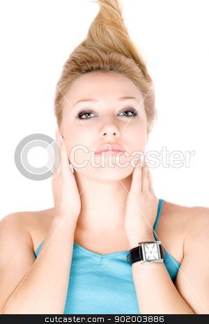 Closeup portrait of pretty blond girl stock photo, Closeup portrait of pretty blond girl lying on a white by Sergii Sukhorukov