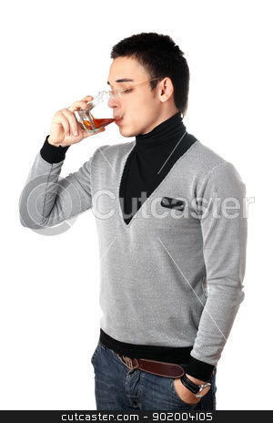 Young man drinking whiskey stock photo, Young man drinking whiskey from a glass by Sergii Sukhorukov