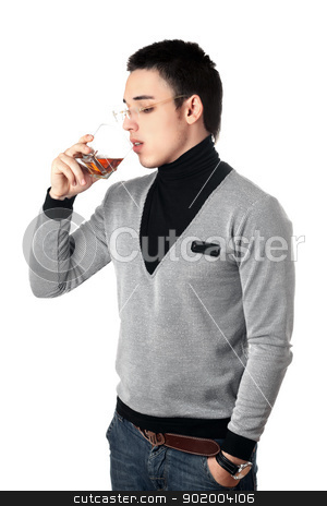 Young man drinking whiskey from a glass stock photo, Young man drinking whiskey from a glass. Isolated by Sergii Sukhorukov