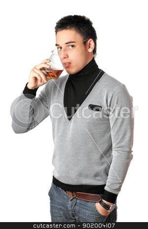 Young man drinking whiskey from a glass. Isolated stock photo, Young man drinking whiskey from a glass. Isolated on white by Sergii Sukhorukov