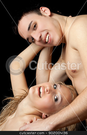 Portrait of a smiling young couple stock photo, Portrait of a smiling young couple. Isolated by Sergii Sukhorukov