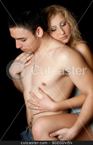 Portrait of attractive loving young couple stock photo, Portrait of attractive loving young couple. Isolated by Sergii Sukhorukov