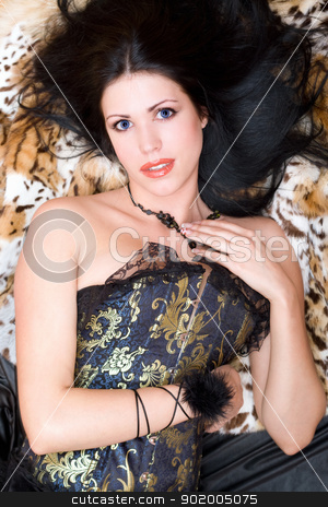 Charming young brunette in a corset stock photo, Charming young brunette in a corset posing on fur by Sergii Sukhorukov