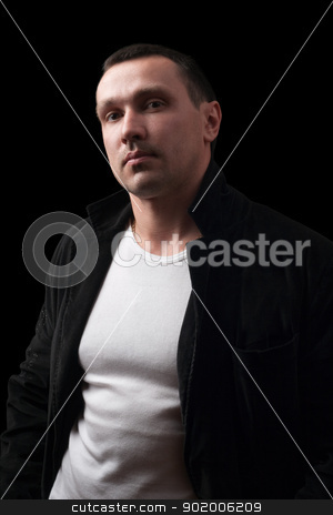 Portrait of a confident man. Isolated stock photo, Portrait of a confident man. Isolated on black by Sergii Sukhorukov